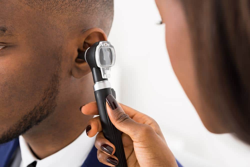 Otoscopy ear examination in an adult